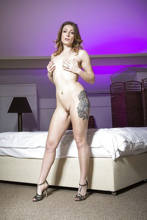 Lon legged Euro MILF Ava Austen poses fully clothed in high heels