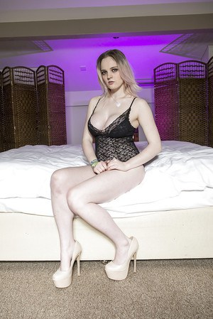 Blonde Euro babe Carly Rae removing dress to pose in black lingerie