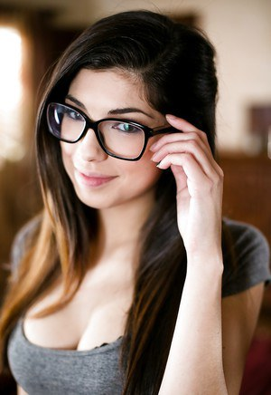Nerdy beauty Ava Taylor posing in underwear and glasses for solo poses