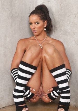 Tanned MILF babe Angel Dark poses in knee high socks while flashing tits