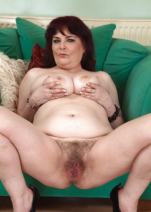 Chunky mature woman Christina X spreads legs and flashes pubic hair