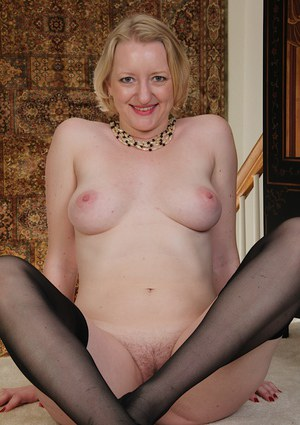 Older Euro woman Anya Volcov posing non nude in black stockings and dress