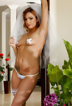 Slutty brunette bride Dahlia Sky showing off her trimmed bush