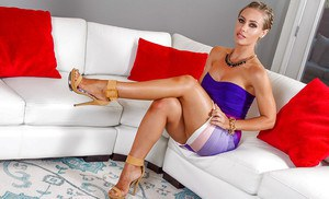Leggy blonde model Nicole Aniston displaying nice legs in knee length skirt