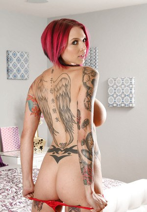 Buxom tattoo model Anna Bell Peaks posing in red lingerie on bed