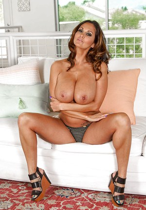 Chesty MILF babe Ava Addams letting massive juggs loose in kitchen
