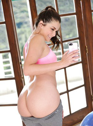 Brunette pornstar Allie Haze baring perfect ass over top of balloon