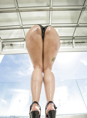 Big bottomed Latina babe Dollie Darko shows off big butt and tight asshole
