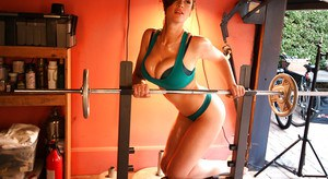 Bodybuilder babe Lana Kendrick and her big tits working out with weights