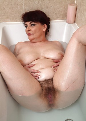 Older lady Christina X baring flabby stomach and hairy pussy