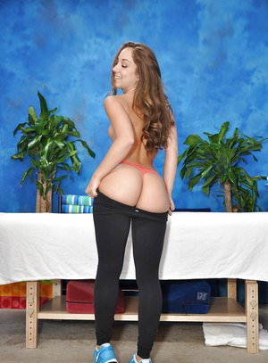 Petite 18 year old babe Remy poses in yoga pants and exposes small boobs
