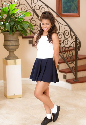 Cute Latina teen babe Gabriella Ford posing non nude in pleated skirt