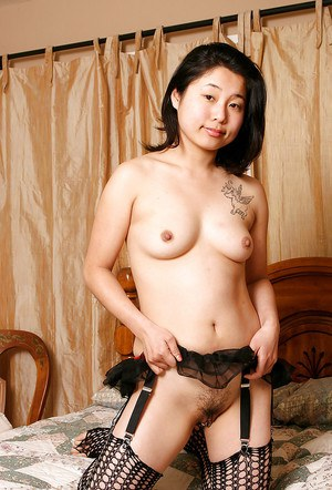 Asian first timer Mini fondles small tits while modelling fishnet stockings