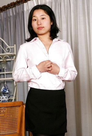 Sexy Asian amateur Mini posing in white shirt and black pantyhose