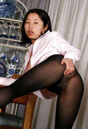 Asian babe Mini pulling pantyhose down legs to bare hairy cunt