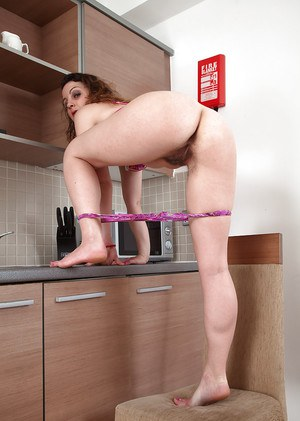 Older housewife Khalisa flashing hairy underarms and pussy in kitchen