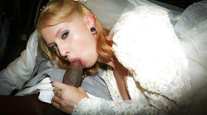 Blonde amateur Joanna Angel blowing big black cock in wedding dress