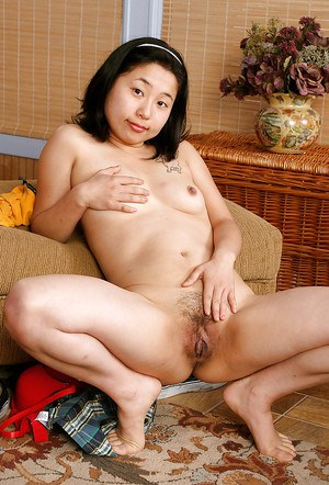 Petite Asian chick Mini undressing and baring small Chinese tits