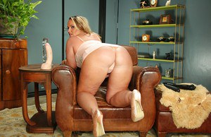 Chunky solo MILF Dee Sirens showing off big fat ass in high heels