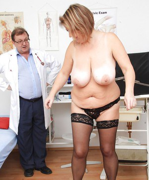 Mature BBW Drahuse stripping down to stockings on hidden camera