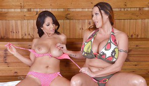 Busty moms Laura Orsolya and Susana Alcalue feel up each others large juggs