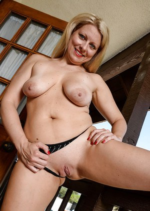 Older blonde lady Zoey Tyler pulls up sweater to expose tits