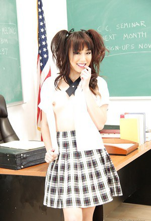 Asian cutie Miko Dai removing schoolgirl uniform in classroom