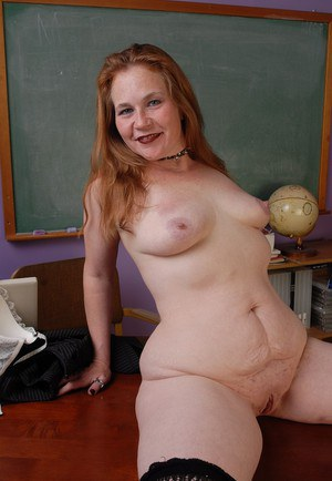 Chubby schoolteacher Spicy displaying slave collar and naked tits