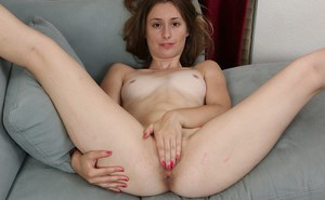 Young chick Lilith Black showing off her painted toes and removing panties