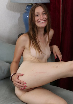 Teen cutie Lilith Black posing in skirt and heels before stripping naked