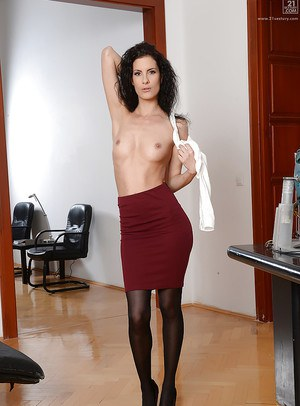 European receptionist Leanna Sweet poses fully clothed in skirt and nylons