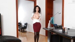 Leggy brunette secretary Leanna Sweet posing in heels, skirt and hose