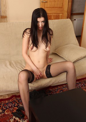 Busty European mom Hanna Black posing in stockings while masturbating