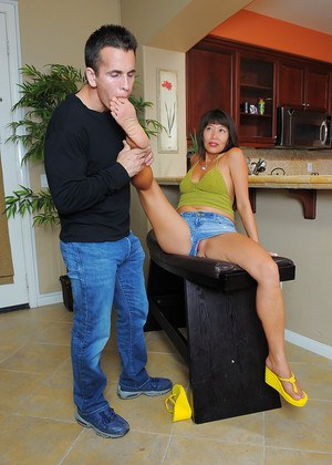 Older Asian lady Sakura Lei jacking dick with her bare feet
