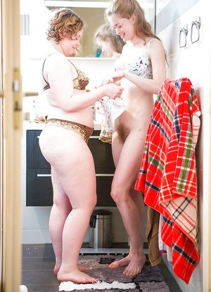 Chubby and skinny girls Laney and Mira get dressed after girl on girl sex