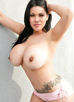 Ana Rica shows off her gigantic titties in a very tight pair of shorts