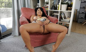 Black haired Asian kya takes off her sexy little mini skirt