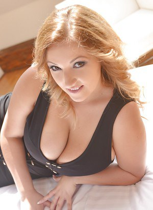 Chubby blonde cutie Krystal Swift posing fully clothed on bed