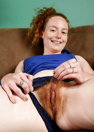 Mature lady Ana Molly exposing her hirsute body and red-haired bush