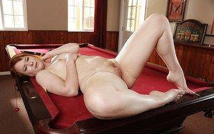 Chubby redhead stripping naked for homemade pics on pool table