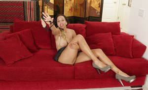 Busty mature Latina Josephine Jones posing topless on couch