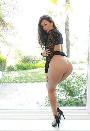 Sultry Latina babe Allie Haze posing fully clothed in sexy lingerie