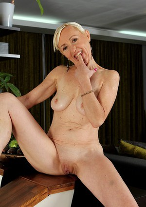 Older blonde woman Tina strips naked and fondles granny tits