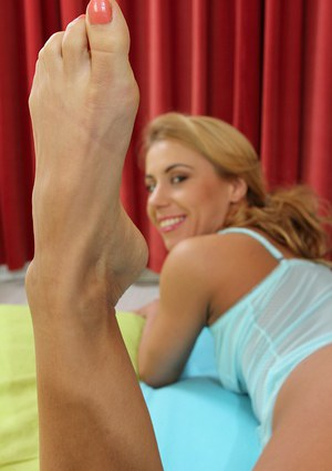 Older woman Nicky Blade showing off barefeet while masturbating bald pussy