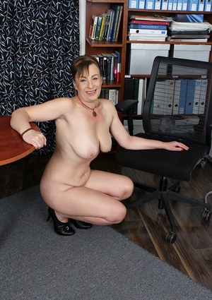 Mature woman Sandra Green fondling tits after stripping naked
