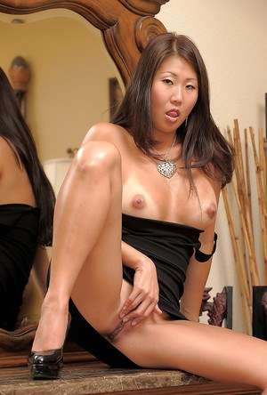 Asian amateur Beti sliding black panties aside to bare shaved pussy