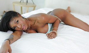 Beautiful black chick Nadia Jay exposing puffy black pussy for close ups
