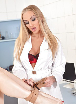Blonde doctor gives her patient a nice and wet pussy check up