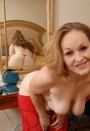 Mature fatty Venus plays with her amazing low hanging titties