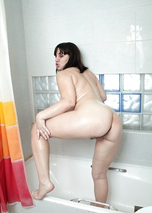Chubby older lady Belta plays with small saggy tits in the shower